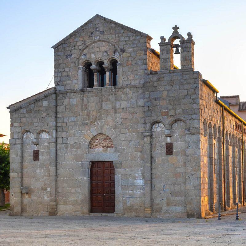 Olbia, Sardinia / Italy - 2019/07/19: XI century medieval Basilica of St. Simplicio - Basilica San Simplicio - at the Piazza San Simplicio square in the historic old town quarter